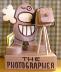 The Photographer  -  Cat No:   -  Click To Order  -  ID: 358
