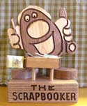 The Scrapbooker  -  Cat No:   -  Click To Order  -  ID: 396